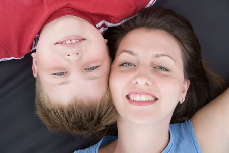 Mum and the son smile. A close up. The top view. photo