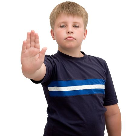 molest: Image of young boy with hand outstretched, warding off any unwelcome situations Stock Photo