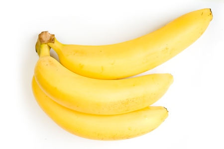 nonfat: three ripe bananas on a white background