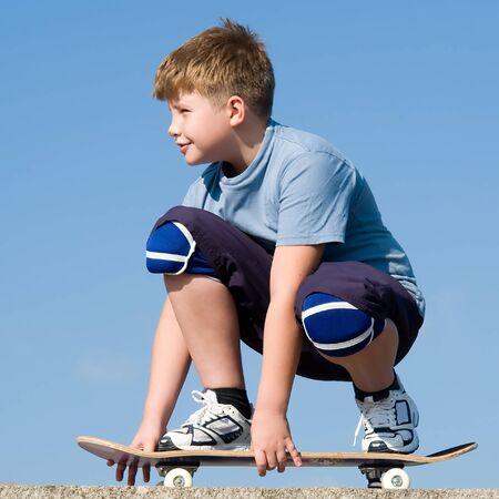 boy with skateboard on a blue sky Stock Photo - 1543613
