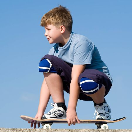 boy with skateboard on a blue sky Stock Photo - 1543613