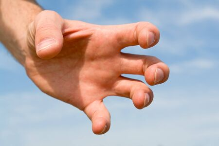 confiscation: confiscation. hand gesture with blue sky at background