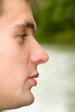 Mans portrait in a profile against the river Stock Photo