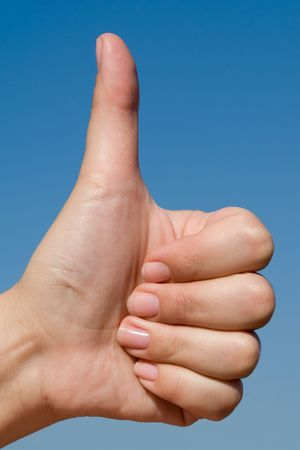 Thumbs up on a blue sky background Stock Photo