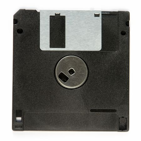 fileserver: Ancient Technology. Black  floppy disc on a white background Stock Photo
