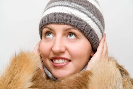 Woman wearing a wool scarf and knit hat. Fall/Winter time. Stock Photo - 1990327