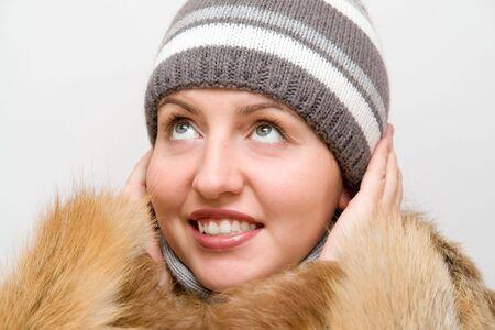 Woman wearing a wool scarf and knit hat. FallWinter time. photo
