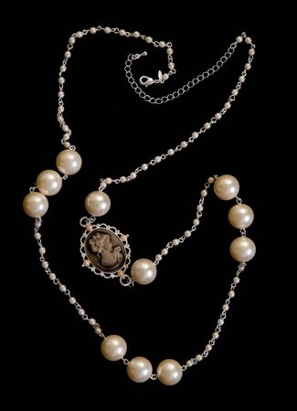coulomb: a beautiful necklace on a black background