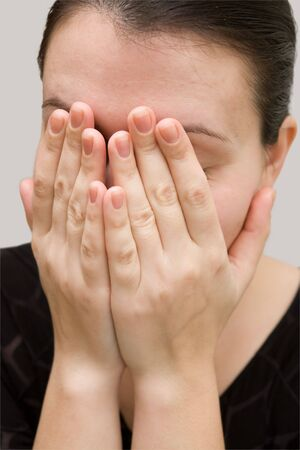 faked: I hid my face in my hands and faked some sobs. Stock Photo