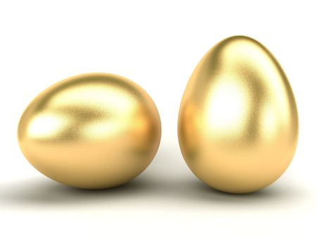 big gold Easter eggs on a white background