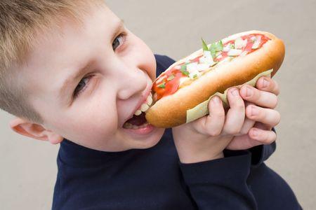 smiling little boy with the big sandwich Standard-Bild