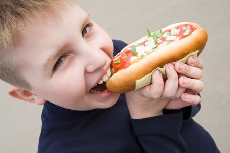 smiling little boy with the big sandwich photo
