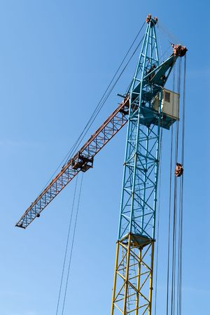 erect: building tower crane against the blue sky Stock Photo