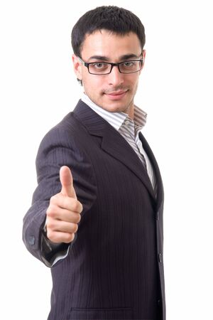 smiling businessman with thumbs up on a white background Foto de archivo