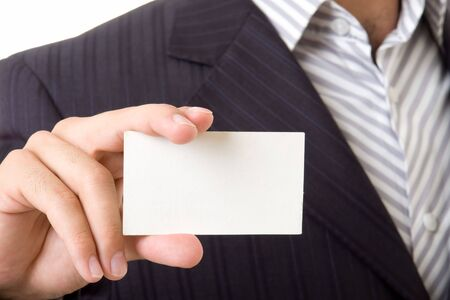 man holds an empty business card. It is ready to your inscription. photo