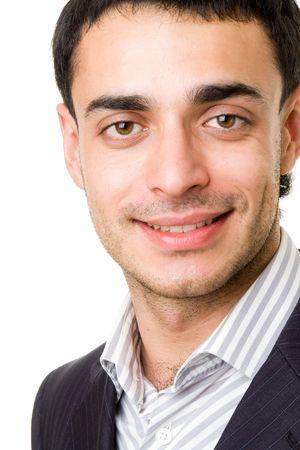 man close up: bella sorridente uomo vicino a uno sfondo bianco
