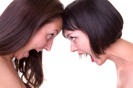 women fighting: Conflict. Two shouting women on a white background. Stock Photo