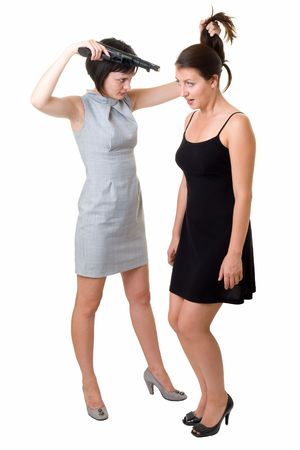 women fighting: Conflict. Woman with the big gun wishes to shoot at the girlfriend. Stock Photo