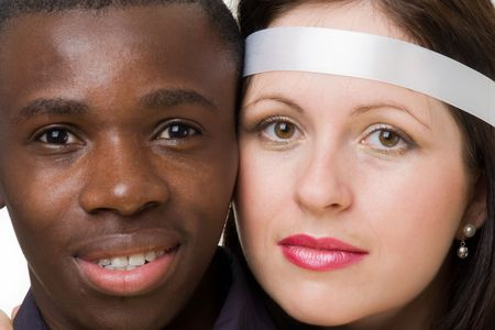 Two faces close up. Black man and white woman. Stock Photo - 3506156