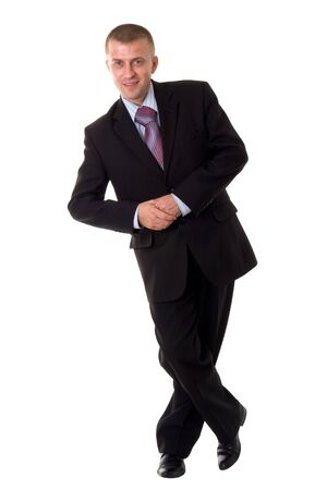 smiling young businessman standing against isolated white background photo