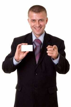 smiling young businessman holding a blank business card, isolated on white background photo