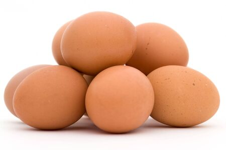fragility: Heap of eggs on a white background