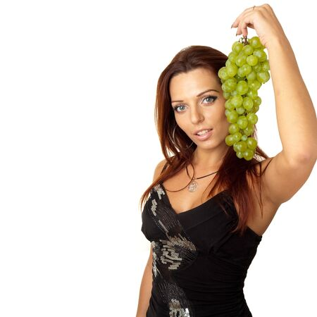 beautiful girl with green grapes on a white background photo