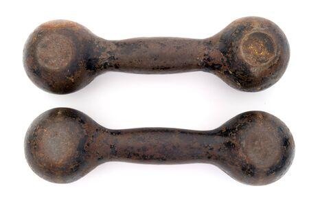 kilograms: old iron dumbells on a white background Stock Photo