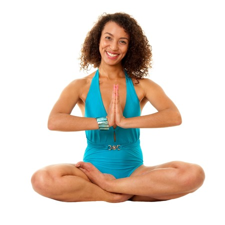 expressing: Yoga. The beautiful woman meditates, sitting on a white background.