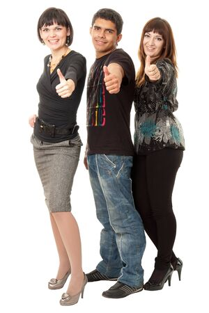 Portrait of three happy friends with thumbs up isolated on white background Stock Photo