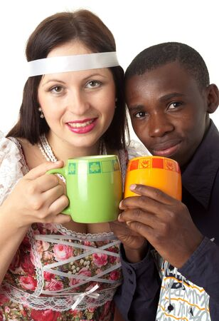 to get warm: Get warm. Black man and white woman drink tea.