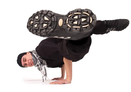 Break dancing. Breakdancer dances on a white background.