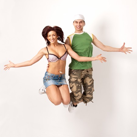Funny people. Happy young couple highly jumps photo
