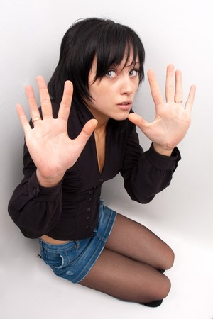 In fright. Young attractive woman in panic Stock Photo - 4341358