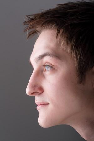 Profile. Beautiful man. The face close up.
