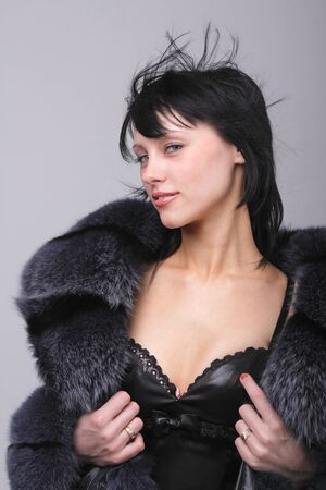 Cold weather fashion. Attractive young woman close up. photo