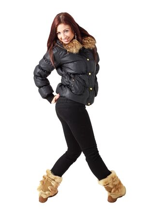 Cold weather fashion. Attractive young woman standing against white background photo