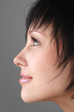Female profile. Beautiful young woman close up.