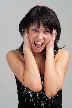 In fright. Young attractive woman in panic Stock Photo - 4369813
