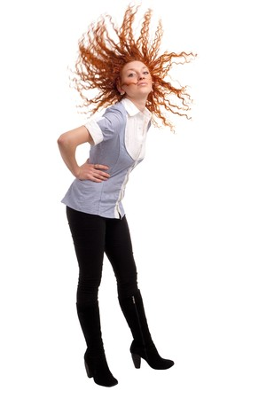 red haired woman: Attractive red haired woman with hair flying