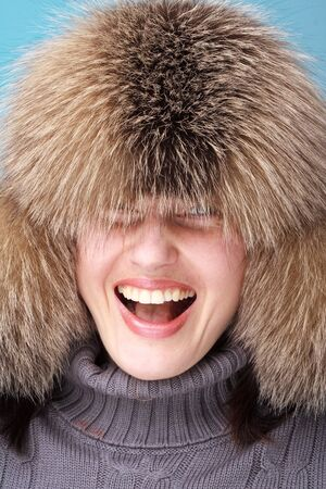 Cold weather fashion. Smiling young woman close up. photo