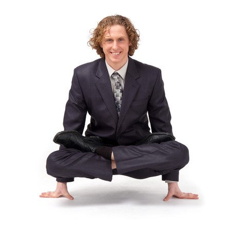 Business yoga. Businessman sitting in full lotus position. Stock Photo - 4490690