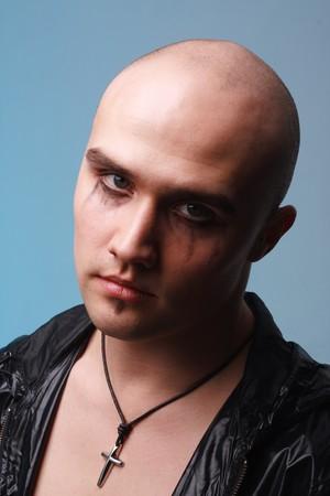 Portrait of a goth man on a blue background photo
