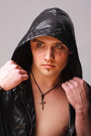 Portrait of a goth man on a grey background photo