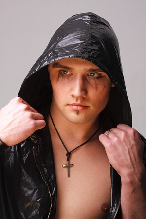 Portrait of a goth man on a grey background Stock Photo - 4490720
