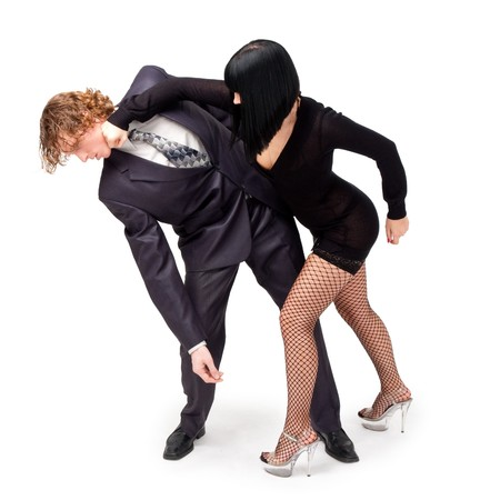 Fight. Young couple on a white background.