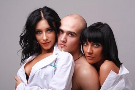 two sexy girls and boy close up Standard-Bild