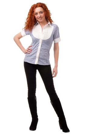 red haired woman: Attractive red haired woman standing against isolated white background