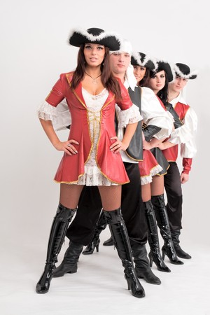 Young dancers in pirate costumes on a gray background photo