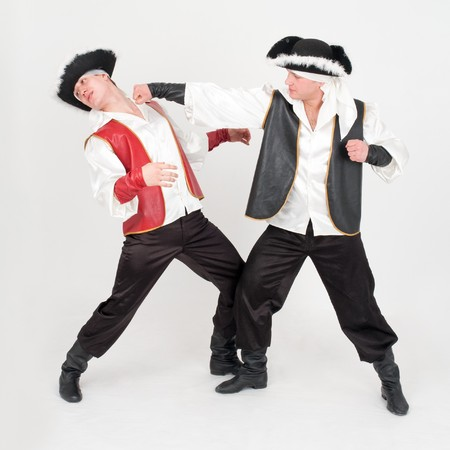 Fight. Two boys in pirate costumes on a gray background Stock Photo - 4542945